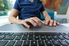 Student behind computer keyboard Royalty Free Stock Photography