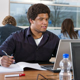 Student behind laptop Royalty Free Stock Photos