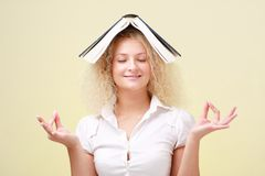 Student with big book meditating Stock Image