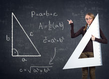 Student with a big ruler and Pythagorean theorem on blackboard Royalty Free Stock Photography