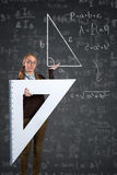 Student with a big ruler and Pythagorean theorem on blackboard Royalty Free Stock Photo