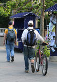 Student with Bike. A student walking his bicycle through campus Stock Photography