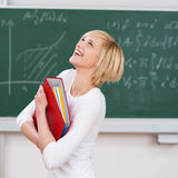 Student With Binder Looking Up Against Chalkboard Stock Images