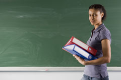 Student on blackboard Stock Images