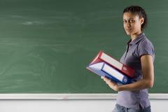Student on blackboard Stock Images