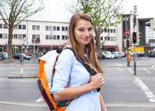 Student with blond hair in the city looking at camera Royalty Free Stock Image