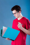 Student with blue binder Royalty Free Stock Photography