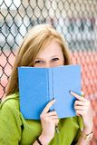 Student with book. Young woman standing with book outdoors Royalty Free Stock Photos