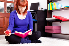 Student with book and apple Stock Image