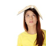 Student with book on her head Stock Photo