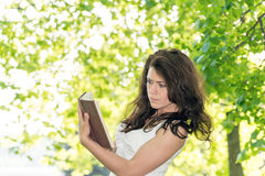 Student with a book in  park Royalty Free Stock Image