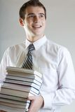 Student with books. Young man standing with books, smiling Royalty Free Stock Photos