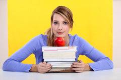 Student with books. And an apple Royalty Free Stock Images