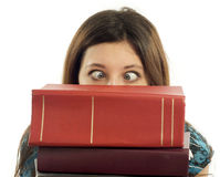 Student books and crossed eyes Stock Photography