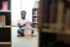 Student With Books And Digital Tablet Sitting In Stock Photography