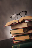 Student books and glasses shot in studio Royalty Free Stock Photo