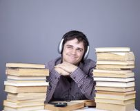 Student with the books and headphone isolated. Royalty Free Stock Images