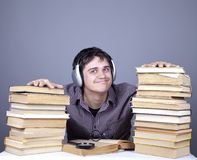 Student with the books and headphone isolated. Royalty Free Stock Photos