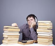Student with the books and headphone isolated. Royalty Free Stock Photo