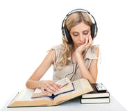 Student with books and headphones. Stock Images