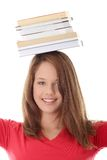 Student with books on her head Royalty Free Stock Photos