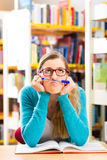 Student with books learning in library Royalty Free Stock Photos