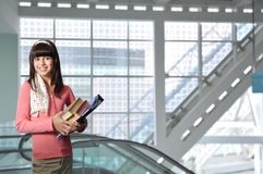 Student With Books in Modern Building Royalty Free Stock Photos