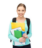 Student with books and schoolbag. Bright picture of smiling student with books and schoolbag Royalty Free Stock Images