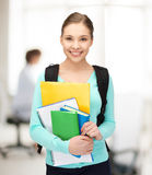 Student with books and schoolbag Stock Photo