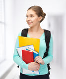 Student with books and schoolbag Stock Images