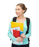 Student with books and schoolbag Royalty Free Stock Photos