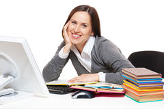 Student with books sitting on workplace. Portrait of smiley student with books sitting on workplace Stock Photo