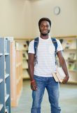 Student With Books Standing In Bookstore Royalty Free Stock Photography