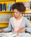 Student With Books Studying At Table In Library Royalty Free Stock Photography