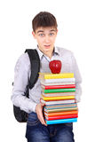 Student with a Books. Surprised Student with Knapsack Holding the Books Isolated on the White Background Stock Image