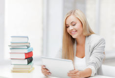 Student with books and tablet pc Royalty Free Stock Image