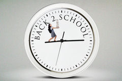 Student with books and walks on the clock Stock Images