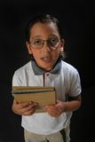 Student boy. With glasses and a book stock photo