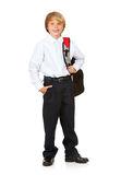 Student: Boy with Backpack and Hand in Pocket. Isolated on white series of a child in student uniform clothing Stock Image