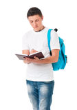 Student boy. Boy student with backpack and notepad, isolated on white background Stock Photography