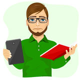 Student boy choosing between tablet and books Stock Photos