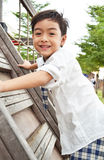 Student boy climb up at playground. Happy and smile stock photography