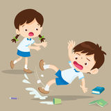 Student boy falling on wet floor. Pupil looking at her friend falling Royalty Free Stock Image