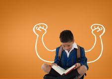 Student boy with fists graphic reading against orange background Royalty Free Stock Photo