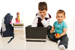 Student boy and hi little borther Stock Photo