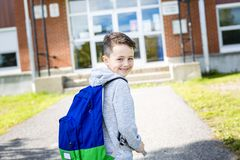 Student outside school standing smiling Royalty Free Stock Photography