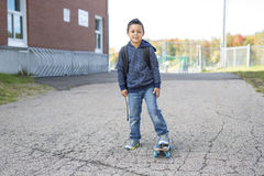 Student outside school standing smiling Royalty Free Stock Images
