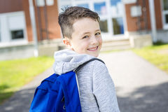 Student outside school standing smiling Royalty Free Stock Image