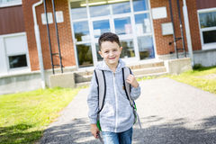Student outside school standing smiling Stock Images