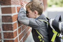 Student boy outside at school standing Royalty Free Stock Photos